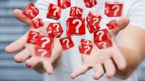 Uomo d'affari facendo uso dei cubi con i punti interrogativi della rappresentazione 3D Fotografie Stock Libere da Diritti