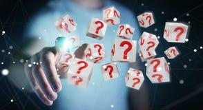 Uomo d'affari facendo uso dei cubi con i punti interrogativi della rappresentazione 3D Fotografia Stock