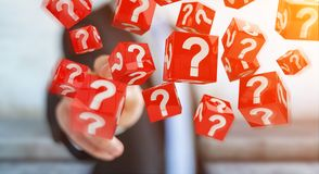 Uomo d'affari facendo uso dei cubi con i punti interrogativi della rappresentazione 3D Fotografie Stock