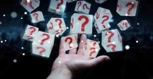 Uomo d'affari facendo uso dei cubi con i punti interrogativi della rappresentazione 3D Immagine Stock Libera da Diritti