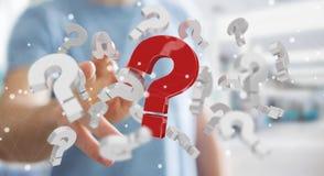 Uomo d'affari facendo uso dei punti interrogativi della rappresentazione 3D Immagine Stock