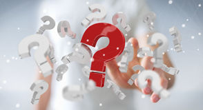 Uomo d'affari facendo uso dei punti interrogativi della rappresentazione 3D Fotografie Stock Libere da Diritti