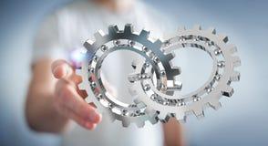 Uomo d'affari facendo uso del fare galleggiare la rappresentazione moderna del meccanismo di ingranaggio 3D Fotografie Stock Libere da Diritti