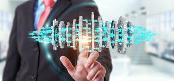 Uomo d'affari facendo uso del fare galleggiare la rappresentazione moderna del meccanismo di ingranaggio 3D Fotografia Stock