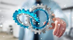 Uomo d'affari facendo uso del fare galleggiare la rappresentazione moderna del meccanismo di ingranaggio 3D Fotografie Stock