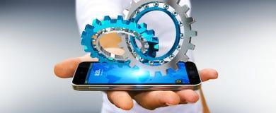 Uomo d'affari facendo uso del fare galleggiare la rappresentazione moderna del meccanismo di ingranaggio 3D Immagini Stock