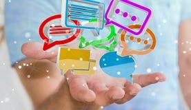 Uomo d'affari facendo uso del ico variopinto digitale di conversazione della rappresentazione 3D Immagine Stock
