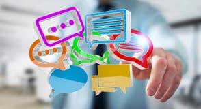 Uomo d'affari facendo uso del ico variopinto digitale di conversazione della rappresentazione 3D Fotografie Stock