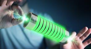 Uomo d'affari facendo uso della batteria verde con la rappresentazione dei fulmini 3D Immagine Stock Libera da Diritti