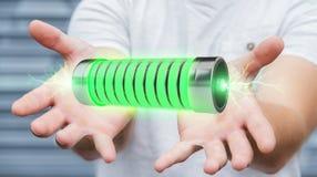 Uomo d'affari facendo uso della batteria verde con la rappresentazione dei fulmini 3D Immagini Stock Libere da Diritti