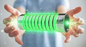 Uomo d'affari facendo uso della batteria verde con la rappresentazione dei fulmini 3D Fotografie Stock Libere da Diritti