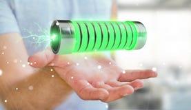 Uomo d'affari facendo uso della batteria verde con la rappresentazione dei fulmini 3D Fotografia Stock