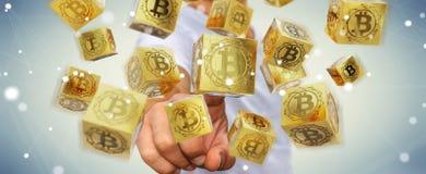 Uomo d'affari facendo uso della rappresentazione di cryptocurrency 3D dei bitcoins Immagini Stock