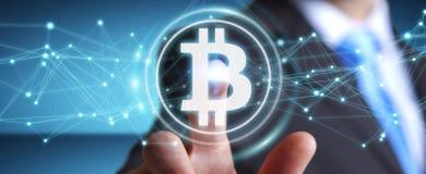 Uomo d'affari facendo uso della rappresentazione di cryptocurrency 3D dei bitcoins Fotografie Stock