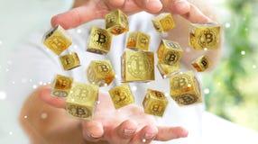Uomo d'affari facendo uso della rappresentazione di cryptocurrency 3D dei bitcoins Fotografia Stock