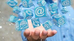 Uomo d'affari facendo uso della rappresentazione di galleggiamento del contatto 3D del cubo Immagine Stock