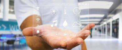 Uomo d'affari facendo uso della rappresentazione domestica astuta dell'interfaccia digitale 3D Immagini Stock Libere da Diritti