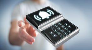 Uomo d'affari facendo uso della rappresentazione domestica del dispositivo di sicurezza dell'allarme 3D Fotografia Stock Libera da Diritti