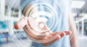 Uomo d'affari facendo uso della rappresentazione libera dell'interfaccia 3D di punto caldo di wifi Immagini Stock Libere da Diritti