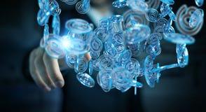 Uomo d'affari facendo uso della sfera blu di arobase digitale da praticare il surfing sull'interno Immagini Stock