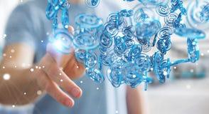 Uomo d'affari facendo uso della sfera blu di arobase digitale da praticare il surfing sull'interno Immagine Stock