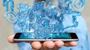 Uomo d'affari facendo uso della sfera blu di arobase digitale da praticare il surfing sull'interno Fotografia Stock Libera da Diritti