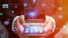 Uomo d'affari facendo uso di uno smartphone con un computer che circonda dal ap Fotografie Stock