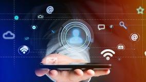 Uomo d'affari facendo uso di uno smartphone con un'icona del contatto che circonda b Immagine Stock