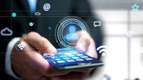 Uomo d'affari facendo uso di uno smartphone con un'icona del contatto che circonda b Fotografia Stock