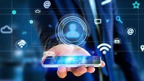 Uomo d'affari facendo uso di uno smartphone con un'icona del contatto che circonda b Immagini Stock Libere da Diritti
