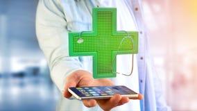 Uomo d'affari facendo uso di uno smartphone con un incrocio della farmacia di illuminazione Fotografie Stock Libere da Diritti