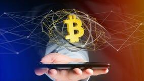 Uomo d'affari facendo uso di uno smartphone con un si cripto di valuta di Bitcoin Immagine Stock