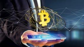 Uomo d'affari facendo uso di uno smartphone con un si cripto di valuta di Bitcoin Fotografia Stock