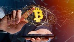 Uomo d'affari facendo uso di uno smartphone con un si cripto di valuta di Bitcoin Immagini Stock