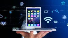 Uomo d'affari facendo uso di uno smartphone con una compressa che circonda dal app Fotografie Stock