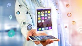 Uomo d'affari facendo uso di uno smartphone con una compressa che circonda dal app Fotografia Stock Libera da Diritti