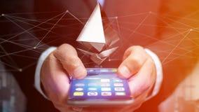 Uomo d'affari facendo uso di uno smartphone con una valuta cripto s di Ethereum Immagini Stock