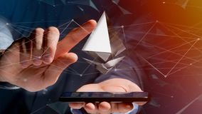Uomo d'affari facendo uso di uno smartphone con una valuta cripto s di Ethereum Fotografia Stock Libera da Diritti