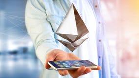 Uomo d'affari facendo uso di uno smartphone con una valuta cripto s di Ethereum Fotografia Stock