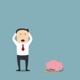 Uomo d'affari fallimento con il porcellino salvadanaio vuoto Fotografia Stock