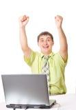 Uomo d'affari felice che aumenta sulle sue proprie mani Fotografia Stock Libera da Diritti