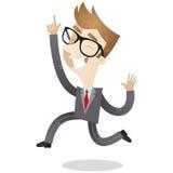 Uomo d'affari felice che salta e che indica Fotografia Stock Libera da Diritti