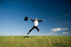 Uomo d'affari felice di salto Fotografia Stock Libera da Diritti