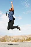 Uomo d'affari felice emozionante che salta nell'aria Immagine Stock Libera da Diritti