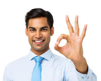 Uomo d'affari felice Gesturing Okay Sign Immagine Stock