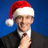 Uomo d'affari festivo sorridente Immagini Stock