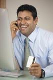 Uomo d'affari a funzioni multiple Immagine Stock