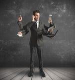 Uomo d'affari a funzioni multiple Immagine Stock Libera da Diritti