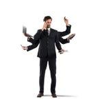 Uomo d'affari a funzioni multiple fotografia stock