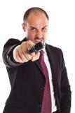 Uomo d'affari furioso con una pistola fotografia stock libera da diritti